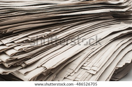 stack of newspapers closeup