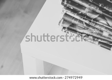 Stack of newspapers, edited in black and white - stock photo