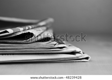 Stack of newspapers in black and white - stock photo