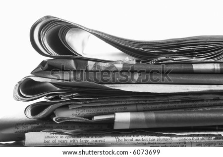 Stack of newspapers isolated on a white background.
