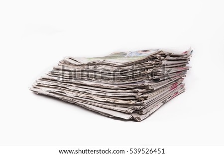 Stack of newspapers isolated on white background.