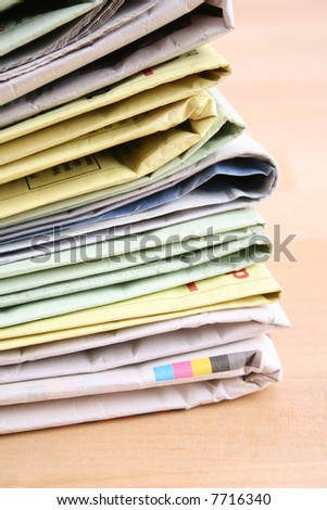 stack of newspapers on the table - close-ups