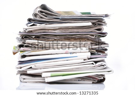 Stack of newspapers on white background. - stock photo