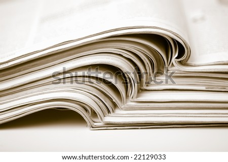 stack of newspapers toned sepia - stock photo