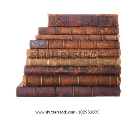 Stack of nine antique books, isolated white background - stock photo