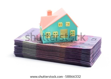 Stack of Notes with Miniature House on White Background - stock photo