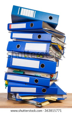 Stack of office folders with blank labels over white background - stock photo