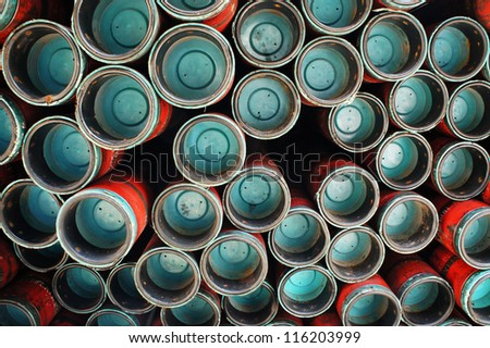 Stack of oil well casing - taking at the box end of casing - stock photo