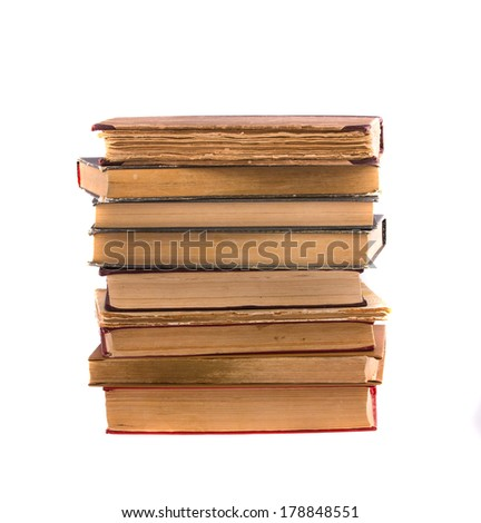 Stack of old antique books, isolated on white background. - stock photo