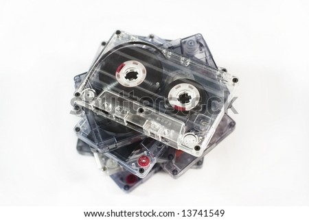 Stack of old audio tapes (on white background)