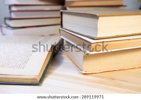 stack of old books on a table