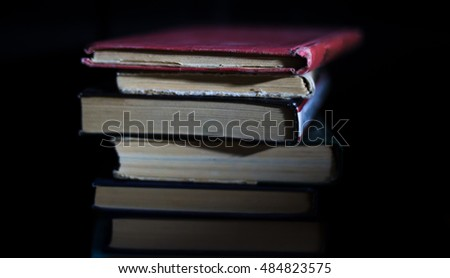 stack of Old books on black surface