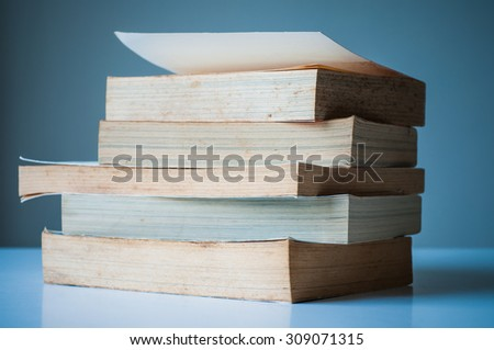 Stack of old books perspective. - stock photo