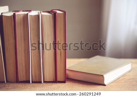 stack of old books,toned image - stock photo