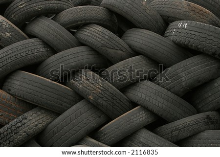 Stack of old car tires in a pattern