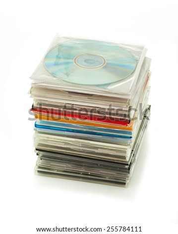 Stack of old CD drive in plastic boxes isolated on white background