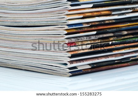 Stack of old colored magazines close-up. - stock photo