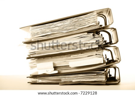 Stack of old documents in binders against white background. Office life. Sepia tone. - stock photo