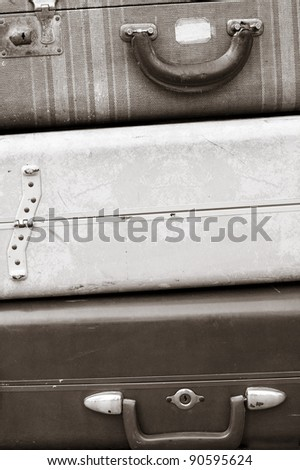 stack of old luggage - stock photo