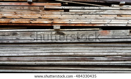 Stack of old lumber for construction, architecture, structure, outdoor, interior, floor, wall finishing.