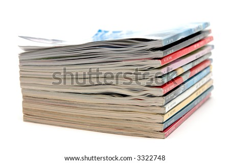 Stack of old magazine in isolated white background
