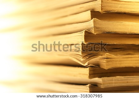 Stack of old magazines as background  in toning - stock photo