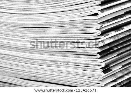 Stack of old magazines close-up. B&W - stock photo