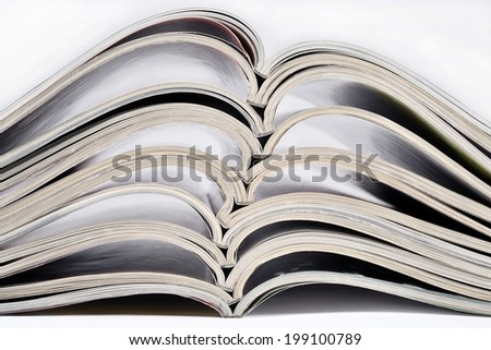 Stack of old magazines closeup - stock photo