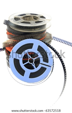 stack of old movie film on plastic reel on white - stock photo