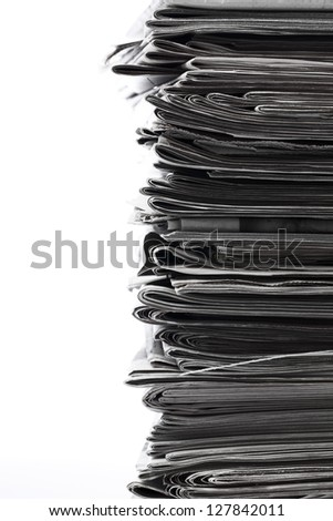 Stack of old newspaper for recycling. - stock photo