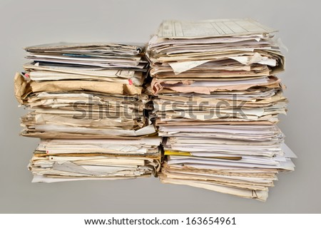 Stack of old newspapers - stock photo