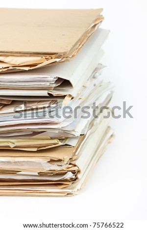 Stack of old paper files isolated on white - stock photo