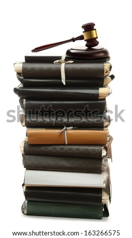 Stack of old paper folders and gavel - stock photo