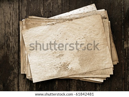 stack of old papers on wooden background
