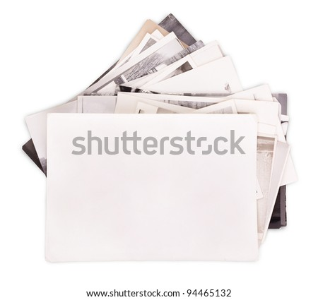 Stack of old photos with empty frame for photo isolated on white - stock photo