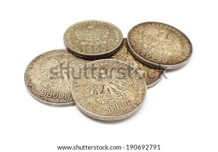 Stack of old polish coins collection lying on white background - stock photo