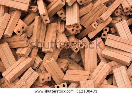 Stack of old red bricks background