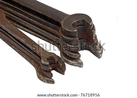 Stack of old rusty wrench, isolated on white background