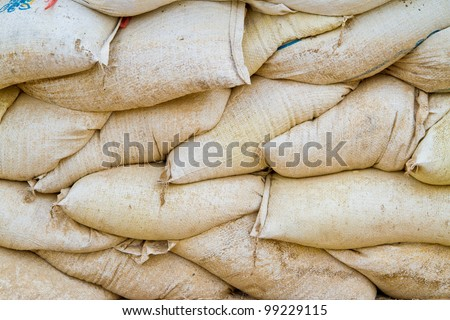 stack of old sand bags - stock photo