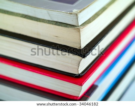 Stack of old textbooks viewed from the corner - stock photo