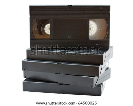 Stack of old VHS video cassettes isolated on white background - stock photo