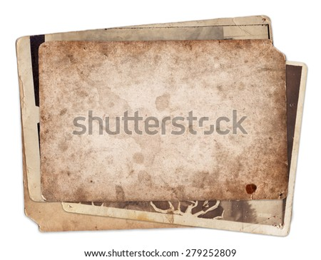 Stack of old vintage photos with stains and scratches background isolated - stock photo