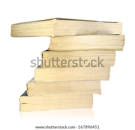 Stack of old worn books isolated on white background  - stock photo