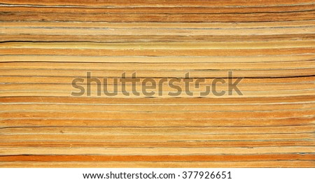 Stack of old yellowed paper books and magazines as a background - stock photo