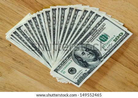 Stack of one hundred dollar bills - stock photo