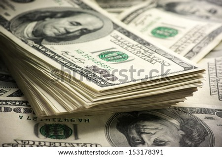Stack of one hundred dollar bills close-up. - stock photo
