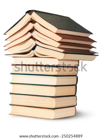 Stack of open and closed old books rotated isolated on white background - stock photo
