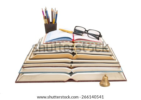Stack of open books with them lying on the pen and glasses on a white background. - stock photo