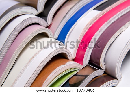 Stack of open color magazines