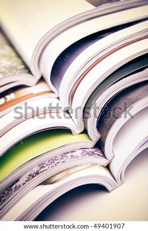 stack of open colorful magazines - close-up